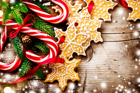 table: Christmas background with christmas cookies and candy canes Stock Photo