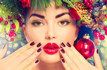 color model: Christmas holiday makeup and manicure closeup