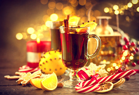 christmas table: Traditional Christmas mulled wine hot drink. Holiday decorated Christmas table