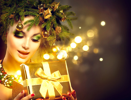 make a gift: Christmas winter woman opening magic Christmas gift box