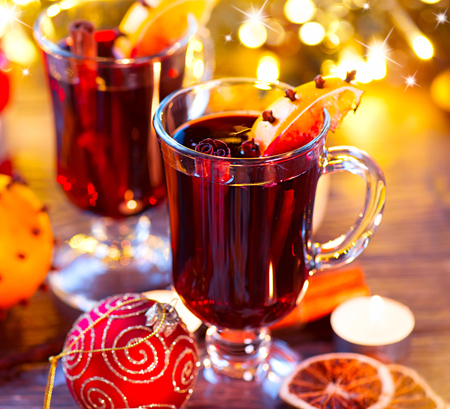 Traditional Christmas mulled wine hot drink. Holiday decorated Christmas table