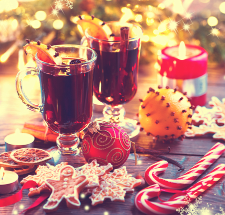table decoration: Traditional Christmas mulled wine hot drink. Holiday decorated Christmas table