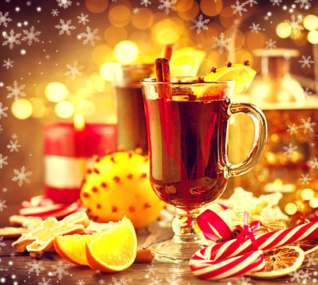Traditional Christmas mulled wine hot drink. Holiday decorated Christmas tabl