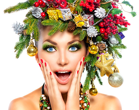 hairstyles: Surprised model with Christmas holiday makeup Stock Photo