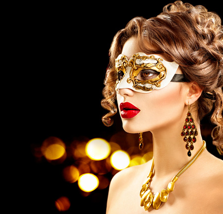 glamor: Beauty model woman wearing venetian masquerade carnival mask at party