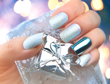Christmas nail art manicure. Winter holiday style bright manicure design Stock Photo - 49609343