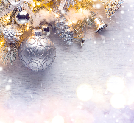 hanging on: Christmas holiday background decorated with baubles and light garland Stock Photo