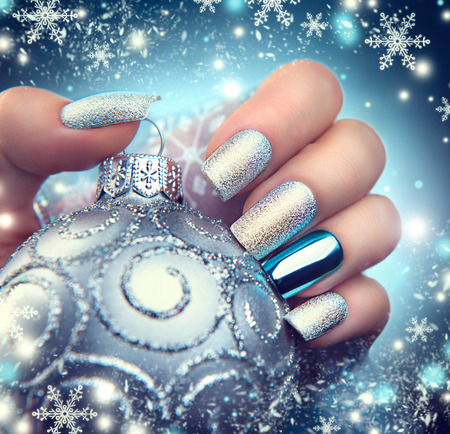 nail care: Christmas nail art manicure. Winter holiday style bright manicure design