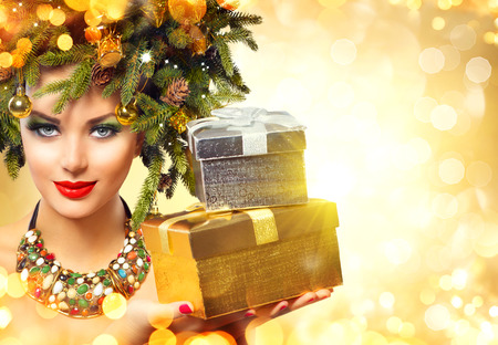 miracle tree: Beautiful winter woman with Christmas gifts