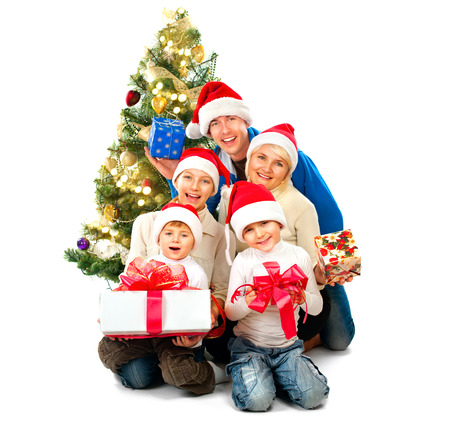 Happy Christmas family with gifts isolated on white photo