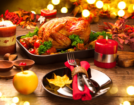 table: Christmas Dinner. Roasted turkey garnished with potato, vegetables and cranberries