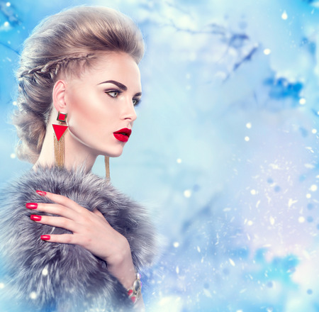 red nail colour: Winter woman in luxury fur coat