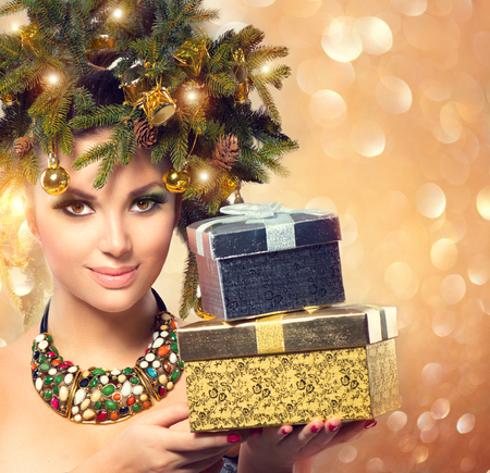 beautiful background: Winter woman holding New Year gifts Stock Photo