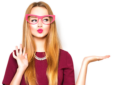 girl glasses: Beauty funny teenage girl presenting point