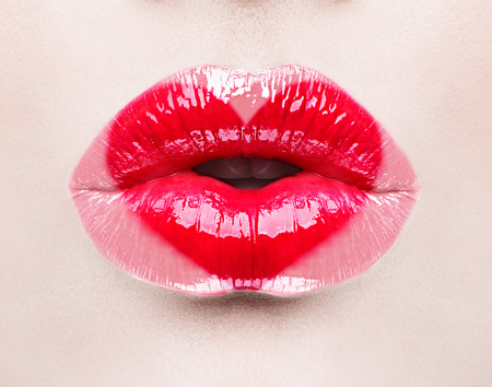 mouth: Beauty sexy lips with heart shape paint. Valentines Day