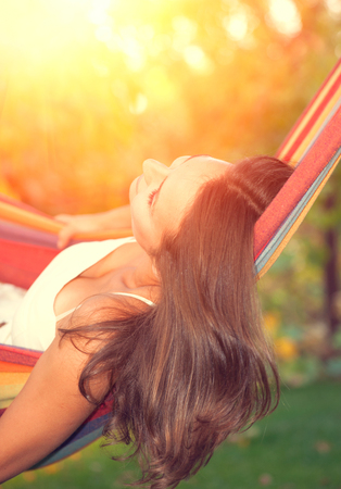 good mood: Beautiful young woman relaxing in hammock Stock Photo