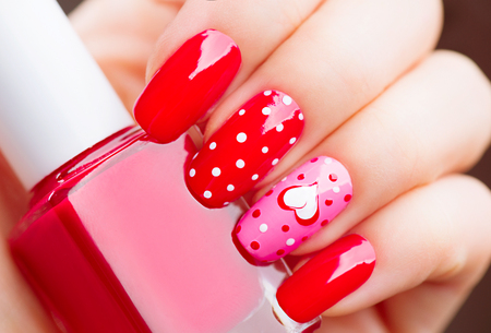 nailpolish: Valentines Day holiday style bright manicure with painted hearts and polka dots