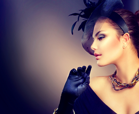 vintage woman: Retro woman portrait. Vintage style girl wearing hat and gloves Stock Photo