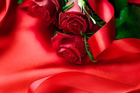 valentine married: Valentines Day red roses bouquet over silk background