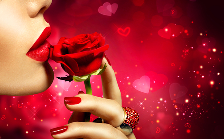 Valentines Day art design. Beautiful model woman kissing red rose flower