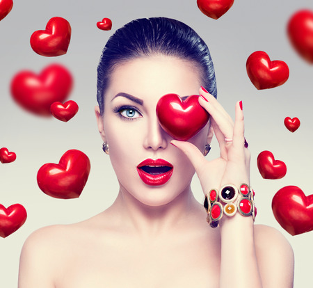 open lips: Fashion woman with red hearts. Valentines day art portrait
