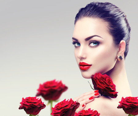 make a gift: Beauty fashion model woman face. Portrait with red rose flowers