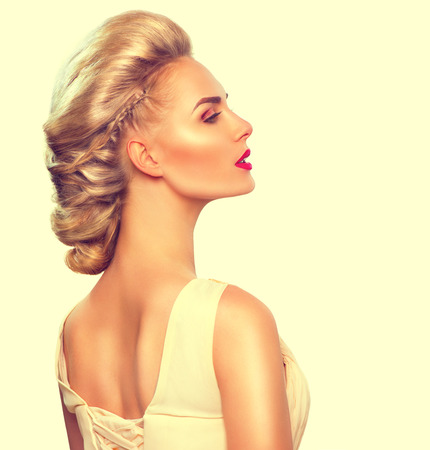 blond hair: Fashion model girl portrait with updo hairstyle