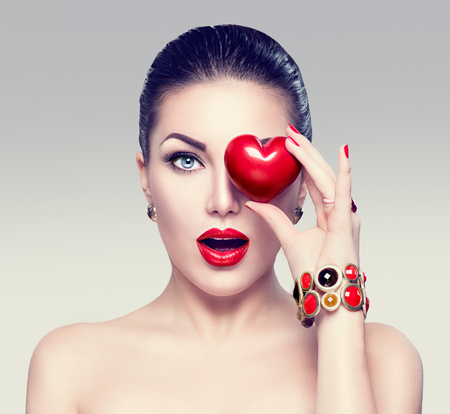 blue eyes girl: Fashion woman with red heart. Valentines day art portrait