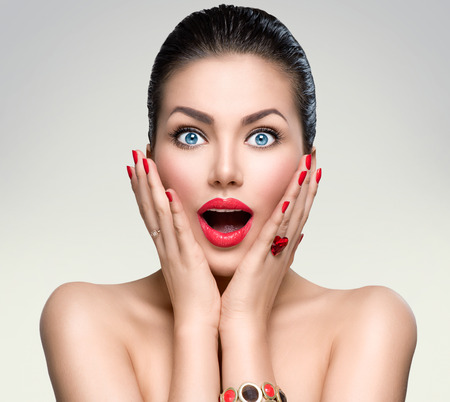 make a gift: Beauty fashion surprised woman portrait