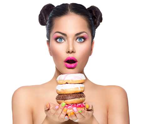 yummy: Beauty fashion model girl taking stack of colorful donuts Stock Photo
