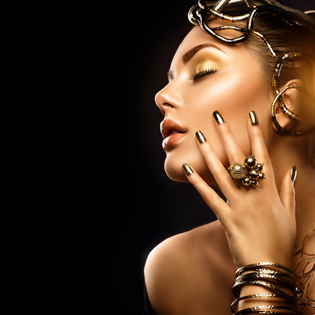 jewelries: Beauty fashion woman with golden makeup, accessories and nails