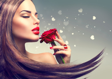 Beauty fashion model woman with red rose flower