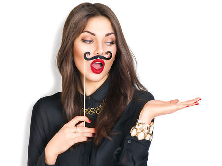 sexy office girl: Surprised model gil holding funny mustache on stick and showing empty copyspace