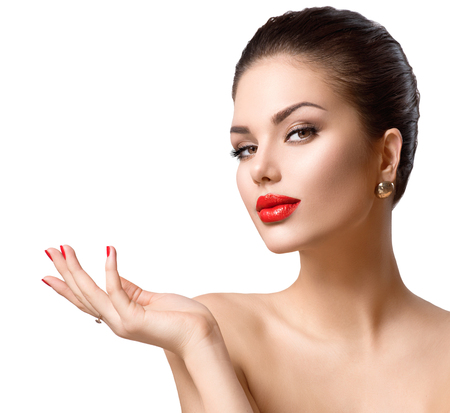 red lip: Beautiful fashion sexy girl showing copy space on the open hand