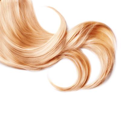Locke von gesundem Haar blond isoliert auf weiß Standard-Bild