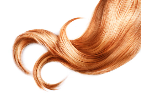 blond streaks: Lock of red hair closeup isolated over white background Stock Photo