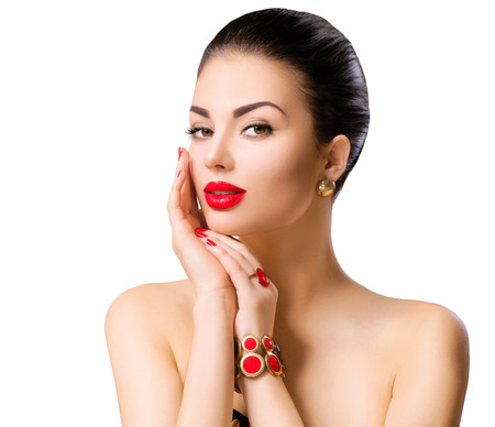 pretty face: Beautiful woman model face portrait with red lipstick and red nails
