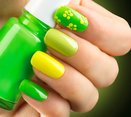 Spring green manicure. Bottle of nail polish Reklamní fotografie - 53239356