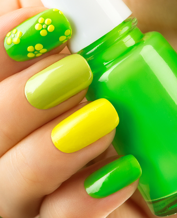 nails woman: Spring green manicure. Bottle of nail polish