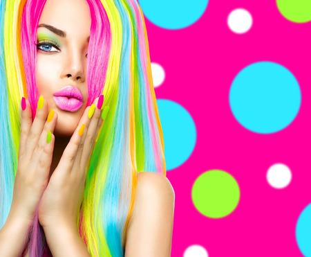 hair model: Beauty girl portrait with colorful makeup, hair and nail polish Stock Photo