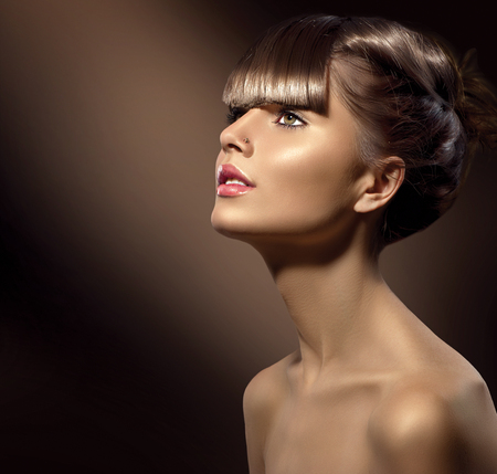 Beauty woman with beautiful makeup and healthy smooth brown hair photo