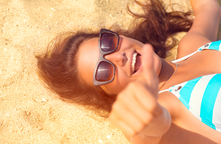 Happy beautiful model girl having fun on the beach. Summer vacation Stock Photo