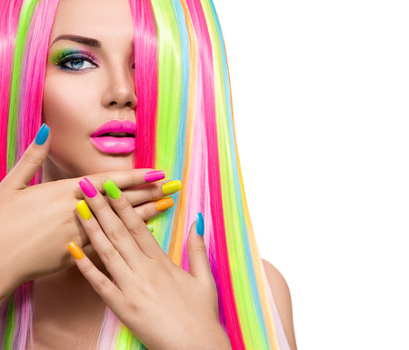 color: Beauty girl portrait with colorful makeup, hair and nail polish Stock Photo