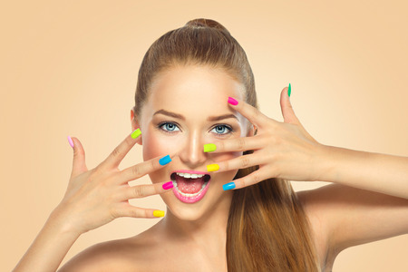 Beauty girl with colorful nail polish. Manicure and makeup Reklamní fotografie - 54846761