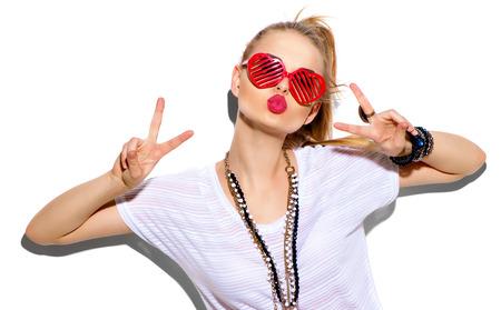 Мода модель девушка, изолированных на белом фоне. Красота стильная блондинка позирует Фото со стока