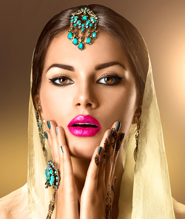 mehndi: Beauty Indian woman portrait. Model girl with mehndi tattoo on her hands