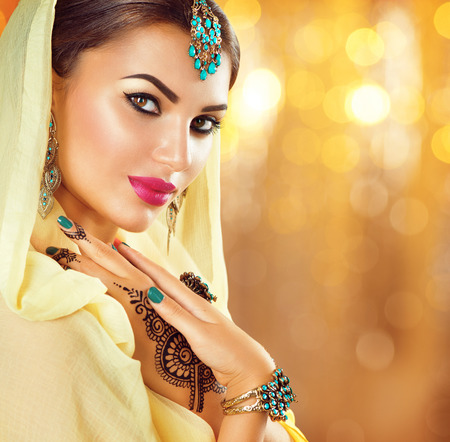 bollywood woman: Arabic beauty girl with black henna tattoos and jewels Stock Photo