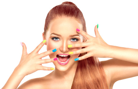 Beauty girl with colorful manicure and fashion makeup Фото со стока