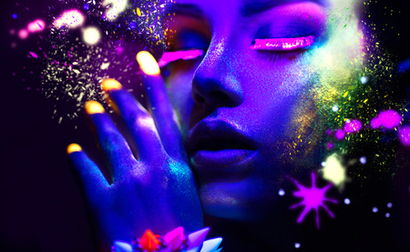 Fashion woman in neon light, portrait of beauty model with fluorescent makeup