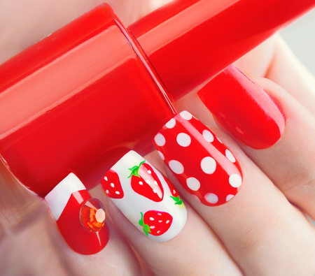 nailart: Nail art manicure. Summer style red manicure with strawberries and polka dots